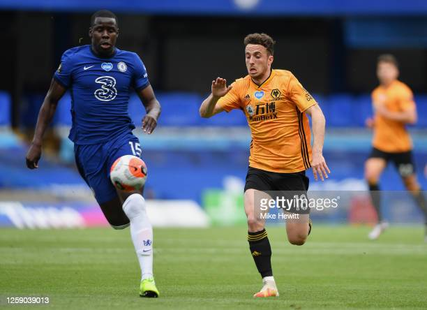 Diogo Jota of Wolverhampton Wanderers and Kurt Zouma of Chelsea compete for the ball during the Premier League match between Chelsea FC and...