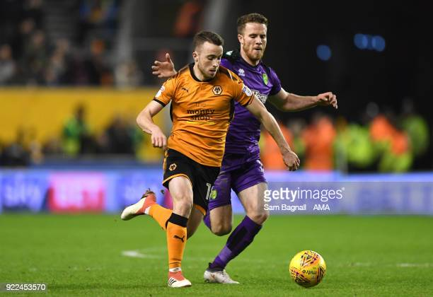 Diogo Jota of Wolverhampton Wanderers and Marley Watkins of Norwich City during the Sky Bet Championship match between Wolverhampton Wanderers and...