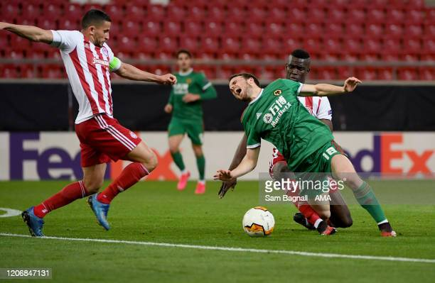 Diogo Jota of Wolverhampton Wanderers and Ousseynou Ba of Olympiacos FC during the UEFA Europa League round of 16 first leg match between Olympiacos...