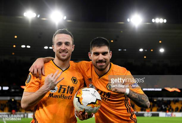 Diogo Jota of Wolverhampton Wanderers and Ruben Neves of Wolverhampton Wanderers celebrate at full time during the UEFA Europa League round of 32...
