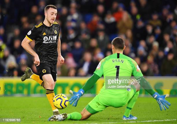Diogo Jota of Wolverhampton Wanderers attempts to shoot but is stopped by Matthew Ryan of Brighton and Hove Albion during the Premier League match...