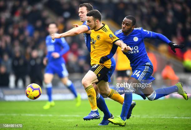 Diogo Jota of Wolverhampton Wanderers battles for possesion with Ricardo Pereira and Jonny Evans of Leicester City during the Premier League match...
