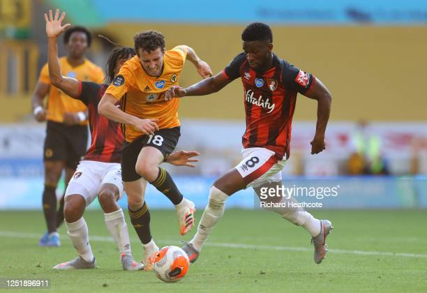 Diogo Jota of Wolverhampton Wanderers battles for possession with Jefferson Lerma of AFC Bournemouth during the Premier League match between...