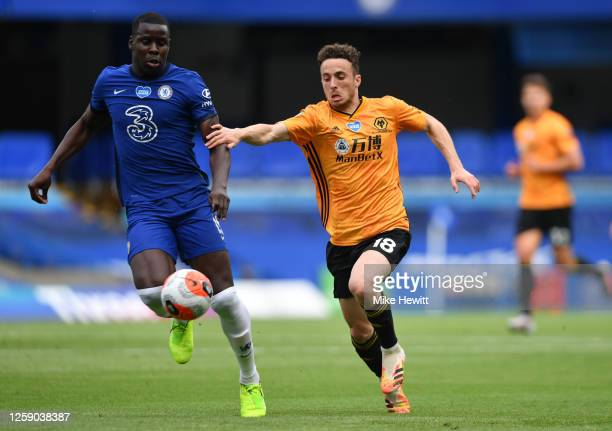 Diogo Jota of Wolverhampton Wanderers battles for possession with Kurt Zouma of Chelsea during the Premier League match between Chelsea FC and...
