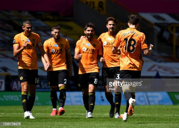 Diogo Jota of Wolverhampton Wanderers celebrates after he scores his teams third goal during the Premier League match between Wolverhampton Wanderers...