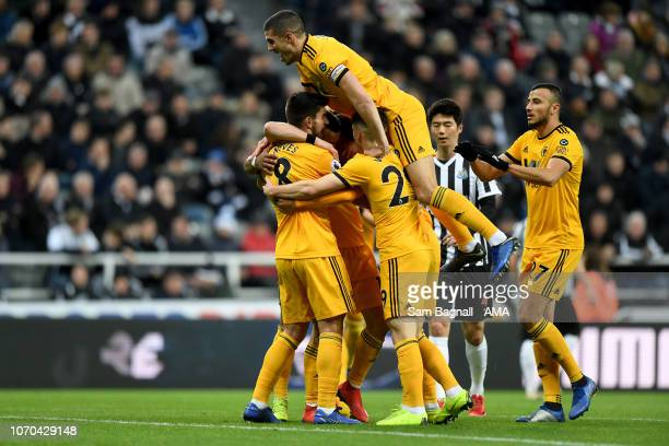 Diogo Jota of Wolverhampton Wanderers celebrates after scoring a goal to make it 01 with Conor Coady of Wolverhampton Wanderers during the Premier...