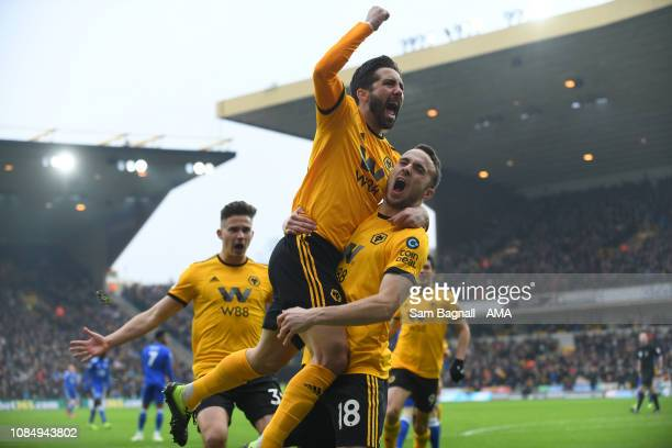 Diogo Jota of Wolverhampton Wanderers celebrates after scoring a goal to make it 1-0 with Joao Moutinho of Wolverhampton Wanderers during the Premier...