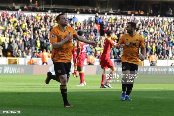 Diogo Jota of Wolverhampton Wanderers celebrates after scoring a goal to make it 1-0 during the Premier League match between Wolverhampton Wanderers...