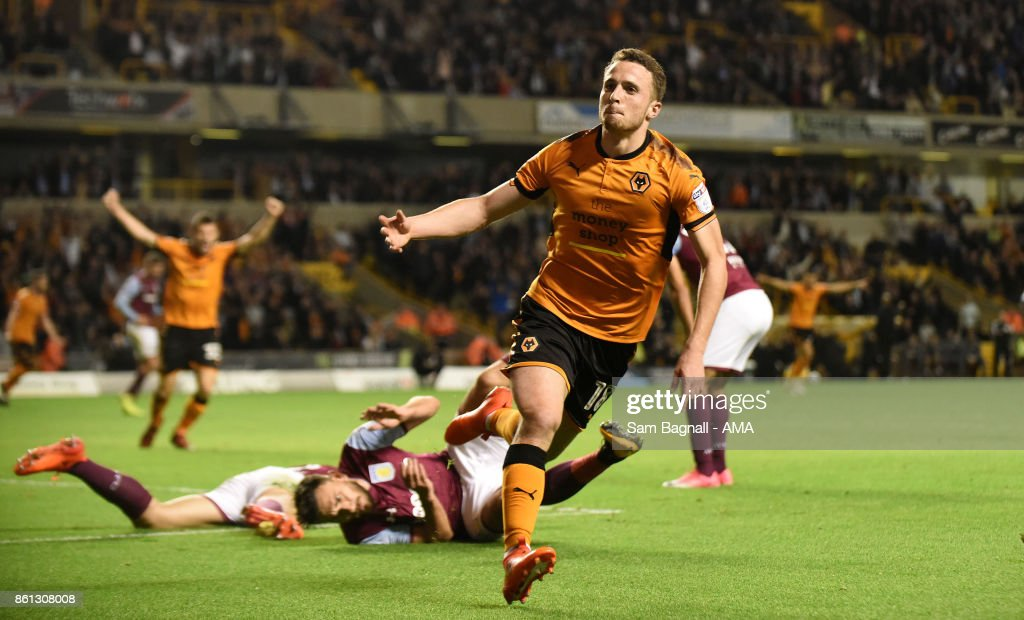 Diogo Jota of Wolverhampton Wanderers celebrates after scoring a goal to make it 1-0 during the Sky Bet Championship match between Wolverhampton and Aston Villa at Molineux on October 14, 2017 in Wolverhampton, England.