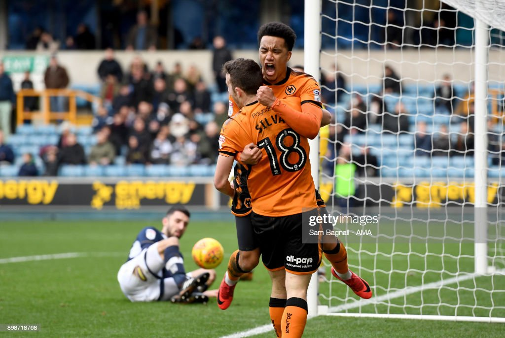 Diogo Jota of Wolverhampton Wanderers celebrates after scoring a goal to make it 1-1 with Helder Costa during the Sky Bet Championship match between Millwall and Wolverhampton at The Den on December 26, 2017 in London, England.