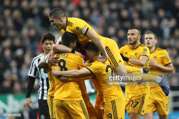 Diogo Jota of Wolverhampton Wanderers celebrates after scoring his team's first goal Conor Coady and team mates during the Premier League match...