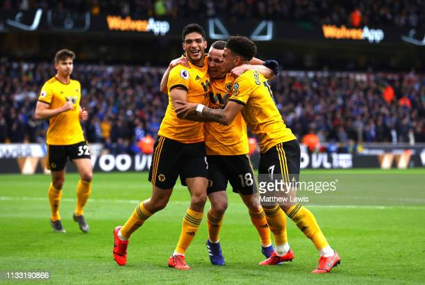 Diogo Jota of Wolverhampton Wanderers celebrates after scoring his team's first goal with Raul Jimenez of Wolverhampton Wanderers and Morgan...