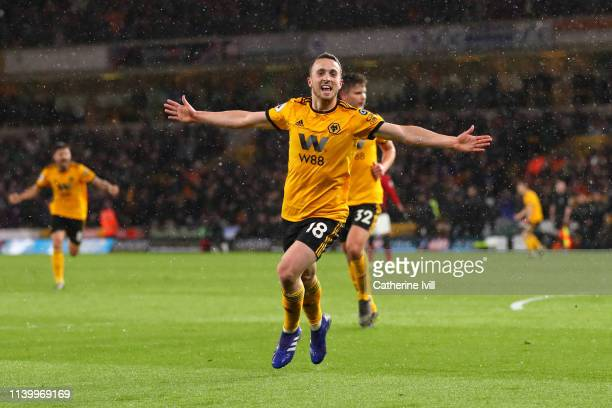 Diogo Jota of Wolverhampton Wanderers celebrates after scoring his team's first goal during the Premier League match between Wolverhampton Wanderers...