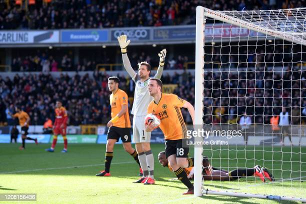 Diogo Jota of Wolverhampton Wanderers celebrates after scoring his sides second goal during the Premier League match between Wolverhampton Wanderers...