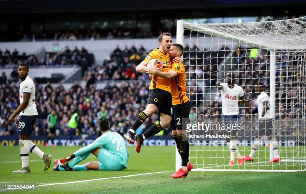Diogo Jota of Wolverhampton Wanderers celebrates after scoring his team's second goal with teammate Matt Doherty during the Premier League match...
