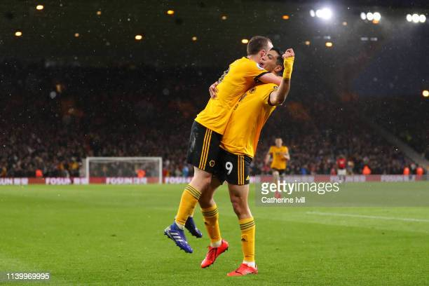 Diogo Jota of Wolverhampton Wanderers celebrates with Raul Jimenez after scoring his team's first goal during the Premier League match between...