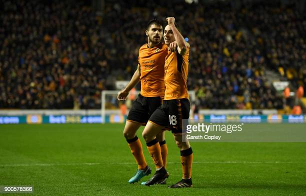 Diogo Jota of Wolverhampton Wanderers celebrates with Ruben Neves of Wolverhampton Wanderers after scoring his team's 3rd goal during the Sky Bet...