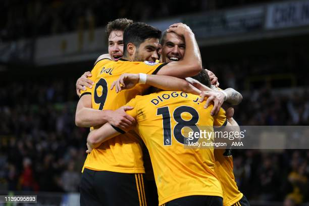 Diogo Jota of Wolverhampton Wanderers celebrates with team mates after scoring a goal to make it 30 during the Premier League match between...