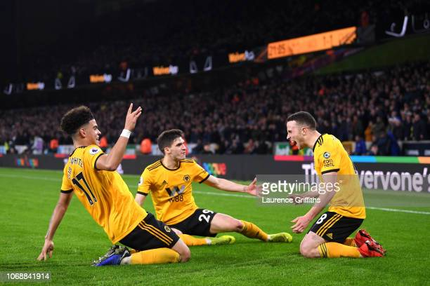 Diogo Jota of Wolverhampton Wanderers celebrates with teammates after scoring his team's second goal during the Premier League match between...
