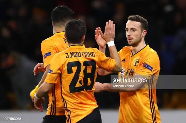 Diogo Jota of Wolverhampton Wanderers celebrates with teammates Raul Jimenez and Joao Moutinho of Wolverhampton Wanderers after scoring his teams...