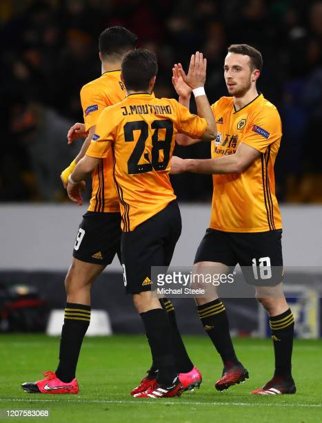 Diogo Jota of Wolverhampton Wanderers celebrates with teammates Raul Jimenez and Joao Moutinho of Wolverhampton Wanderers after scoring his teams...