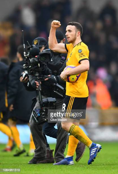 Diogo Jota of Wolverhampton Wanderers celebrates with the matchball at fulltime after scoring a hattrick during the Premier League match between...