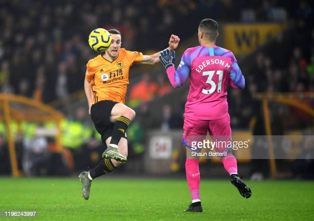 Diogo Jota of Wolverhampton Wanderers clashes with Ederson of Manchester City leading to a red card for Ederson during the Premier League match...