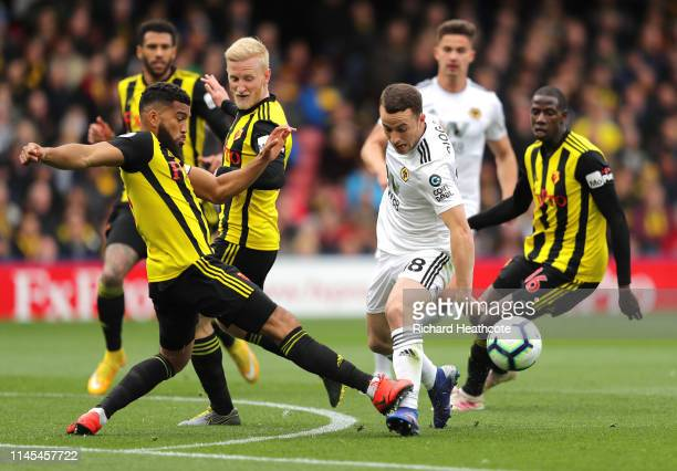 Diogo Jota of Wolverhampton Wanderers is challenged by Adrian Mariappa of Watford during the Premier League match between Watford FC and...