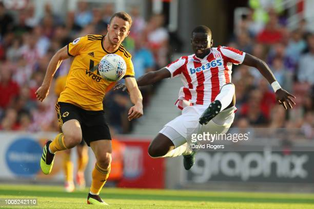 Diogo Jota of Wolverhampton Wanderers is challenged by Badou during the preseason friendly match between Stoke City and Wolverhampton Wanderers at...