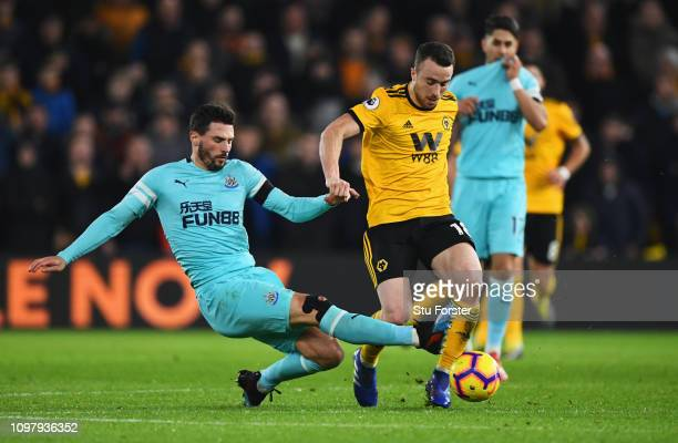 Diogo Jota of Wolverhampton Wanderers is challenged by Fabian Schar of Newcastle United during the Premier League match between Wolverhampton...