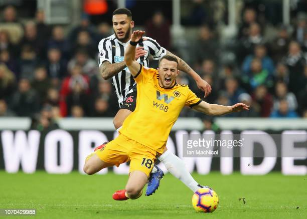 Diogo Jota of Wolverhampton Wanderers is challenged by Jamaal Lascelles of Newcastle United during the Premier League match between Newcastle United...