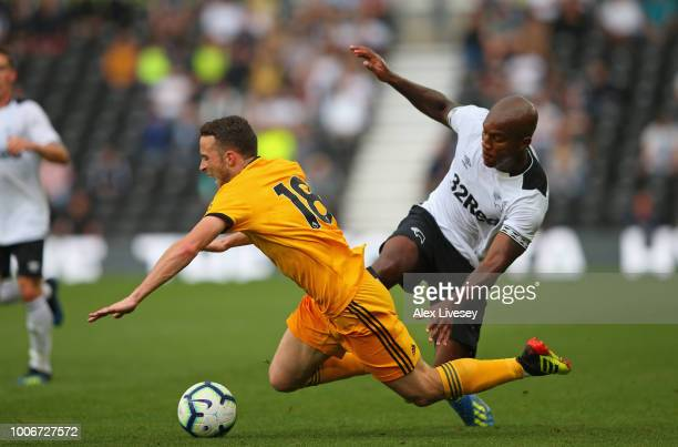 Diogo Jota of Wolverhampton Wanderers is fouled by Andre Wisdom of Derby County during a preseason friendly match between Derby County and...