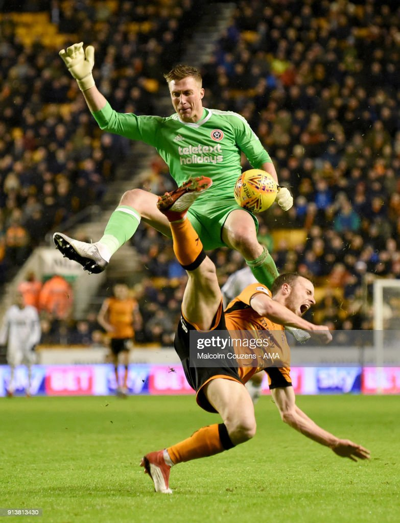 Diogo Jota of Wolverhampton Wanderers is fouled by goalkeeper Simon Moore of Sheffield United who received a red card for his challenge. during the Sky Bet Championship match between Wolverhampton and Sheffield United at Molineux on February 3, 2018 in Wolverhampton, England.