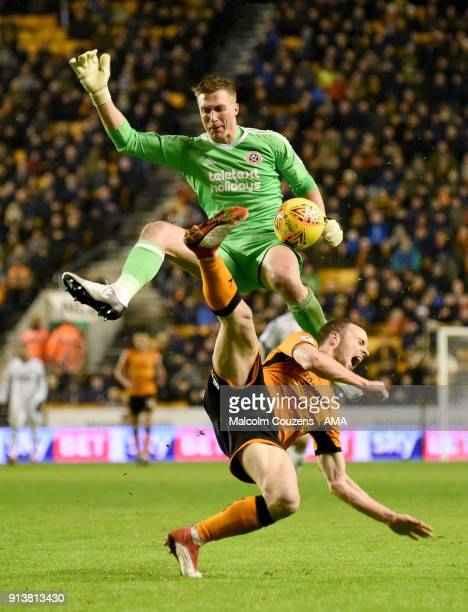 Diogo Jota of Wolverhampton Wanderers is fouled by goalkeeper Simon Moore of Sheffield United who received a red card for his challenge during the...