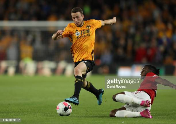 Diogo Jota of Wolverhampton Wanderers moves away from Aaron WanBissaka during the Premier League match between Wolverhampton Wanderers and Manchester...