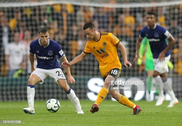 Diogo Jota of Wolverhampton Wanderers passes the ball under pressure from Seamus Coleman of Everton during the Premier League match between...