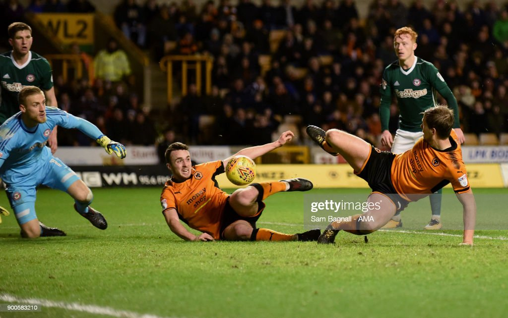 Diogo Jota of Wolverhampton Wanderers scores a goal to make it 3-0 during the Sky Bet Championship match between Wolverhampton and Brentford at Molineux on January 2, 2018 in Wolverhampton, England.