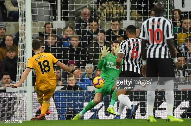 Diogo Jota of Wolverhampton Wanderers scores his team's first goal past Martin Dubravka of Newcastle United during the Premier League match between...