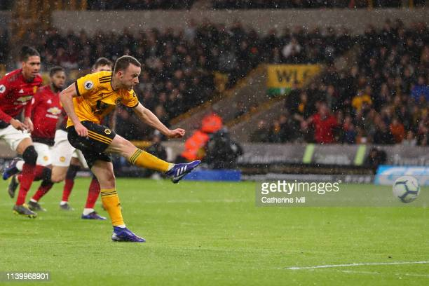 Diogo Jota of Wolverhampton Wanderers scores his team's first goal during the Premier League match between Wolverhampton Wanderers and Manchester...