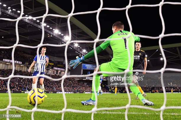 Diogo Jota of Wolverhampton Wanderers scores his team's first goal past Matthew Ryan of Brighton and Hove Albion during the Premier League match...