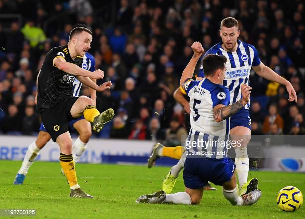 Diogo Jota of Wolverhampton Wanderers scores his team's second goal during the Premier League match between Brighton & Hove Albion and Wolverhampton...