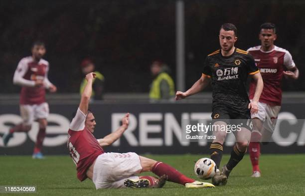 Diogo Jota of Wolverhampton Wanderers with Joao Palhinha of SC Braga in action during the Group K UEFA Europa League match between SC Braga and...