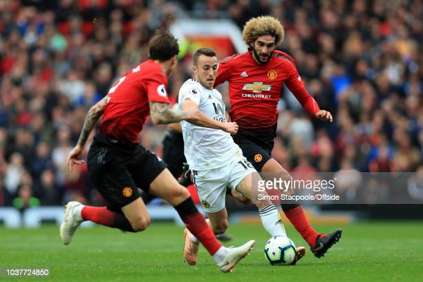 Diogo Jota of Wolves battles with Marouane Fellaini of Man Utd during the Premier League match between Manchester United and Wolverhampton Wanderers...