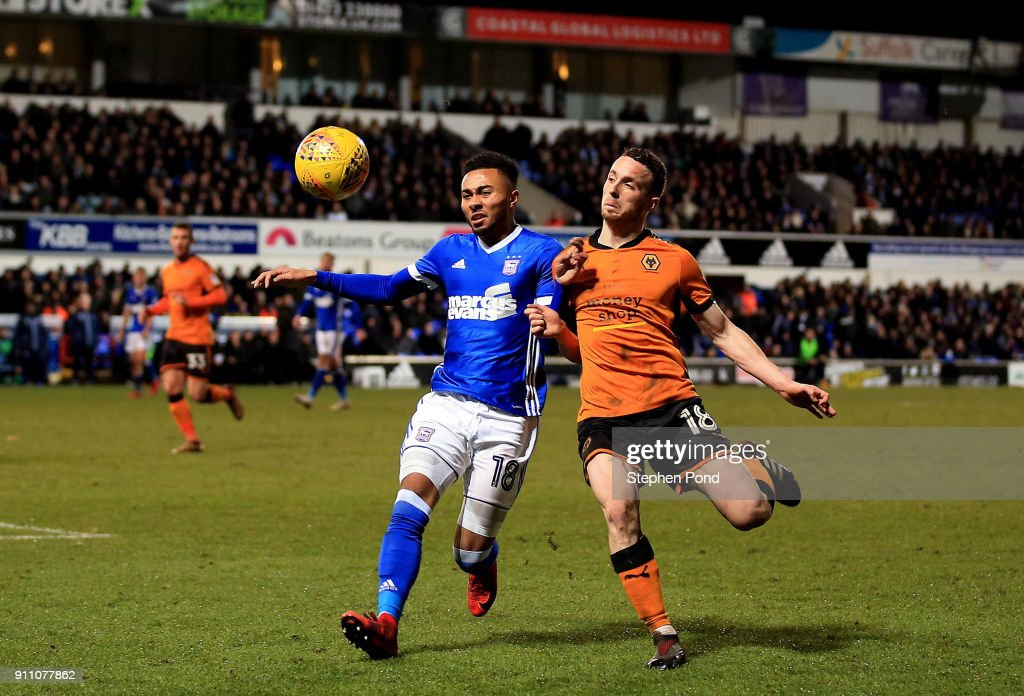 Diogo Jota of Woverhampton Wanderers and Grant Ward of Ipswich Town compete for the ball during the Sky Bet Championship match between Ipswich Town and Wolverhampton Wanderers at Portman Road on January 27, 2018 in Ipswich, England.