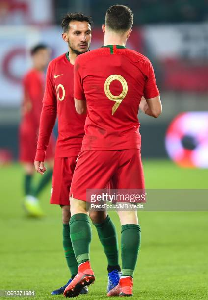 Diogo Jota passes the captain's armband Joao Carvalho of Portugal U21 during the European Under21 Championship Qualifier match between Poland U21 and...
