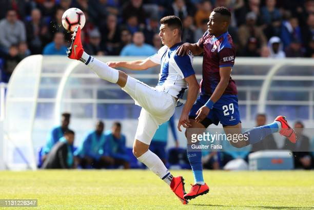 Diogo Leite of FC Porto B with Stanley Awurum of CD Cova da Piedade in action during the Ledman Liga Pro match between CD Cova da Piedade and FC...