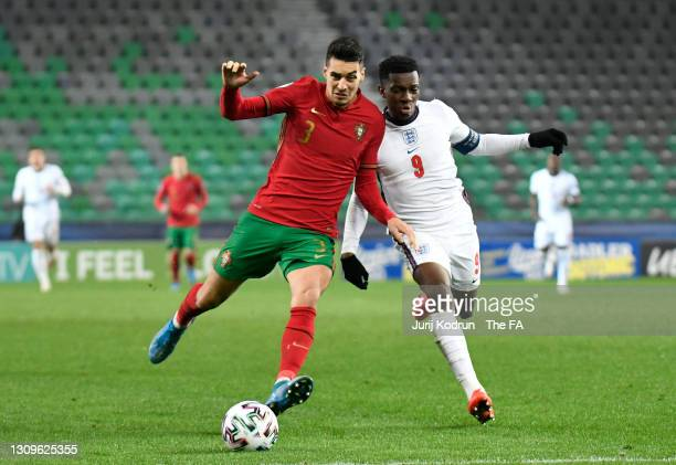 Diogo Leite of Portugal battles for possession with Eddie Nketiah of England during the 2021 UEFA European Under-21 Championship Group D match...