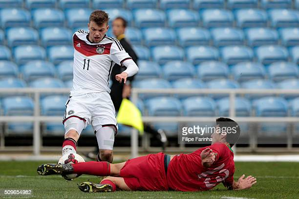 Diogo Leite of Portugal challenges Manuel Wintzheimer of Germany during the UEFA Under17 match between U17 Portugal v U17 Germany on February 9 2016...