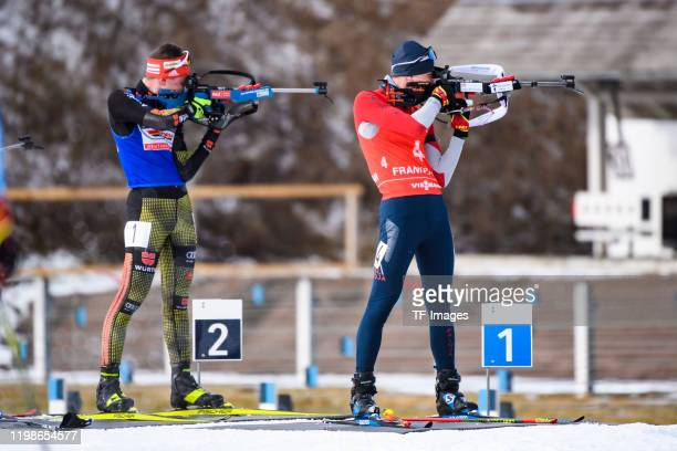 Diogo Martins of Germany and Linus Maier of Germany at the shooting range during the DSV Deutschlandpokal Biathlon Oberhof on January 26, 2020 in...