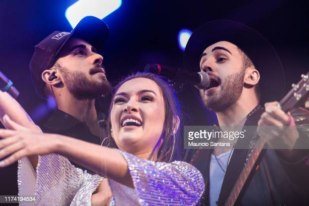 Diogo Melim Gabriela Melim and Rodrigo Melim of Melim performs live on stage during day 7 of Rock In Rio Music Festival at Cidade do Rock on October...